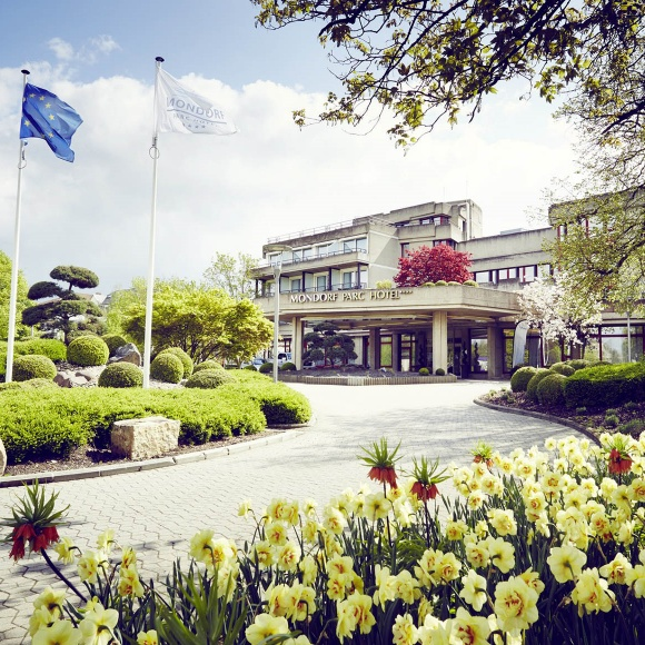The entrance to the Mondorf Parc Hotel with the Luxembourg flag flying in the foreground.