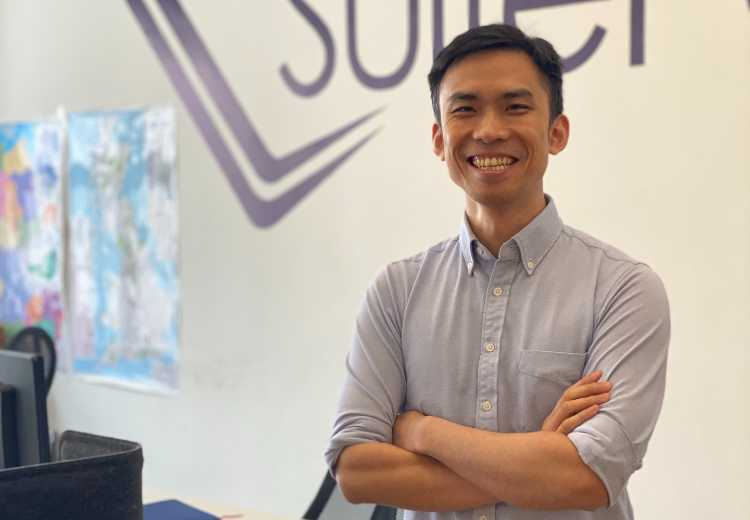 Alex Fong, SuitePad's new VP of engineering, standing and smiling in the SuitePad office.