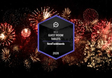 Fireworks display with badge stating SuitePad's Best Guest Room Tablet award